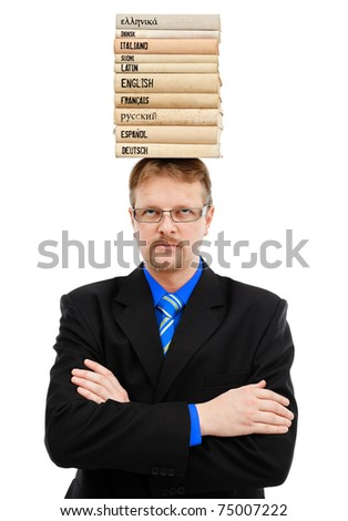 Man with lots of stacked language books on head