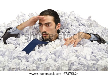 Man with lots of waste paper - stock photo