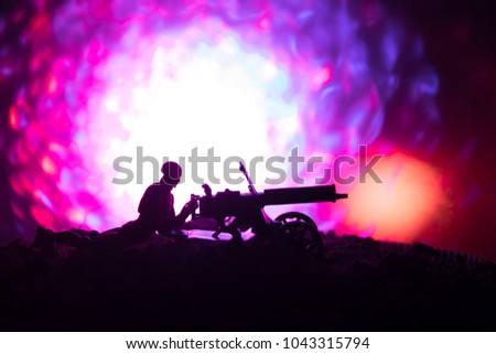 Man with Machine gun at night, fire explosion background or Military silhouettes fighting scene on war fog sky background, World War Soldiers Silhouettes Below Cloudy Skyline At night. Attack scene.