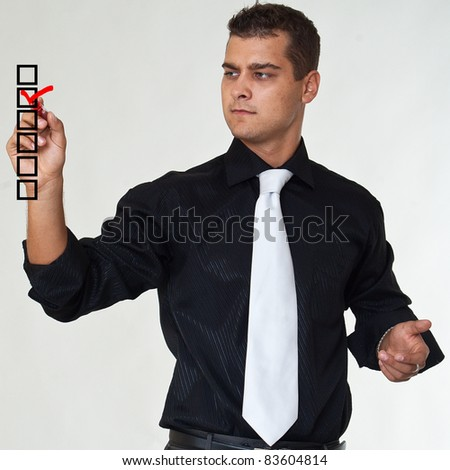 Man with marker write check sign - stock photo