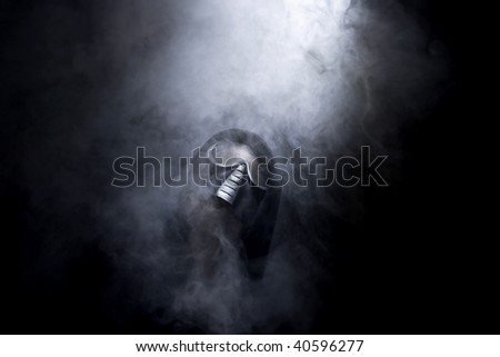 man with mask in abstract smoke
