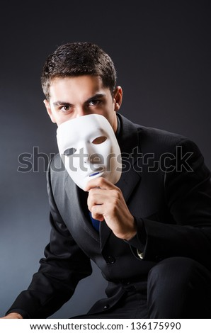 Man with mask in the dark - stock photo