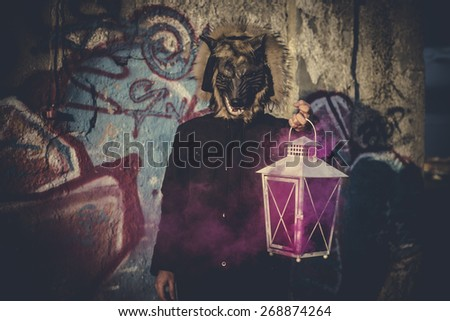 man with mask wolf and lamp with colored smoke - stock photo