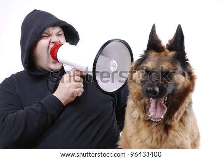 man with megaphone and dog (note: the dog is just yawning!)