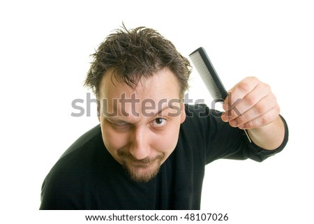 man with messy hair, holding a comb - stock photo