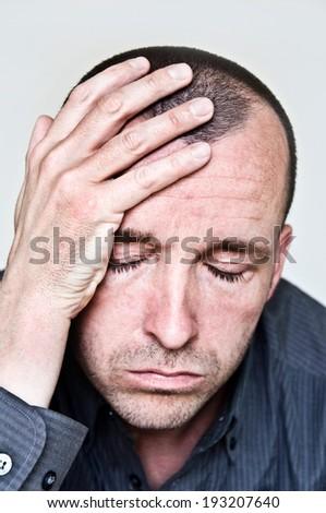 man with migraine - stock photo