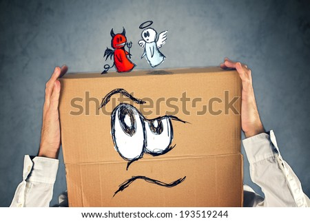 Man with moral dilemma. Doodle drawing of angel and devil fighting. Concept of conscience; decisions, uncertainty, moral dilemma, fight of good and evil. - stock photo