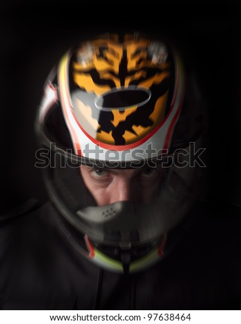 Man with motorcycle helmet on black background - stock photo
