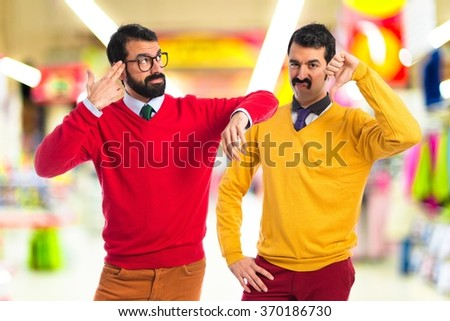 Man with moustache doing bad signal  - stock photo
