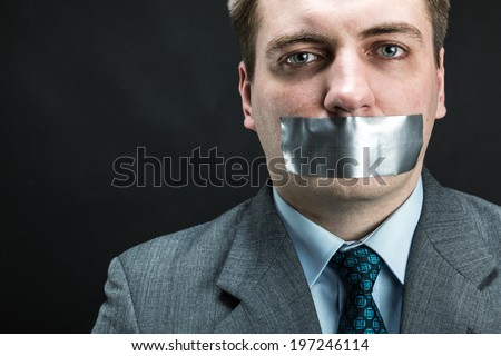 Man with mouth covered by masking tape