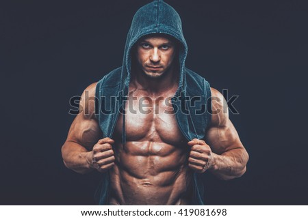 Man with muscular torso. Strong Athletic Men Fitness Model Torso - stock photo