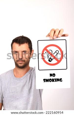 man with non smoke sign - stock photo