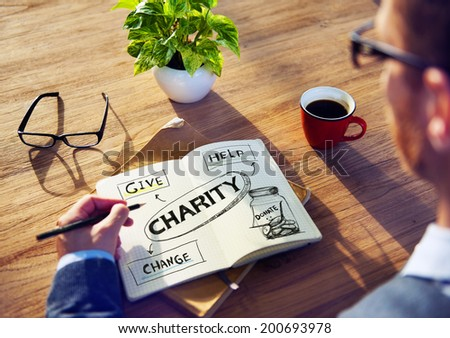 Man with Note Pad and Charity Concepts - stock photo
