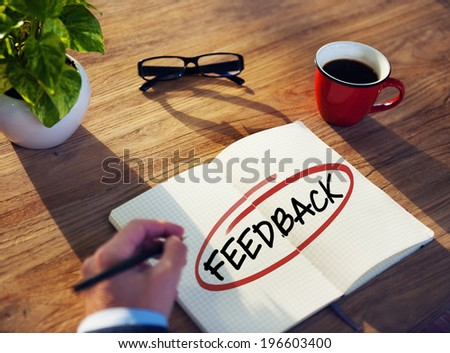 Man with Note Pad and Feedback Concepts - stock photo