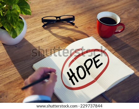 Man with Note Pad and Hope Concept - stock photo