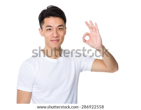 Man with ok sign gesture - stock photo