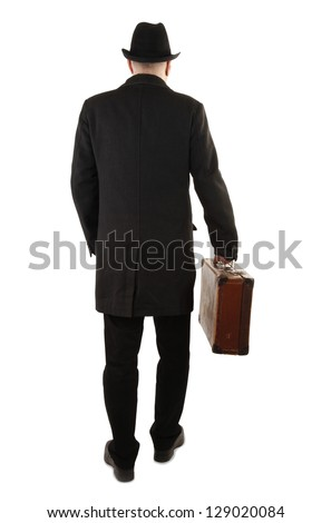 Man with old suitcase rear view - stock photo