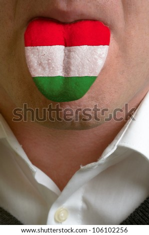 man with open mouth spreading tongue colored in hungary flag as symbol of values like teaching, learning, multilingual speaking of different languages