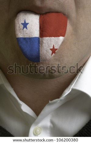man with open mouth spreading tongue colored in panama flag as symbol of values like teaching, learning, multilingual speaking of different languages - stock photo