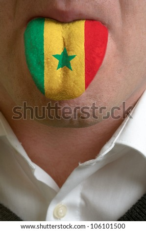 man with open mouth spreading tongue colored in senegal flag as symbol of values like teaching, learning, multilingual speaking of different languages
