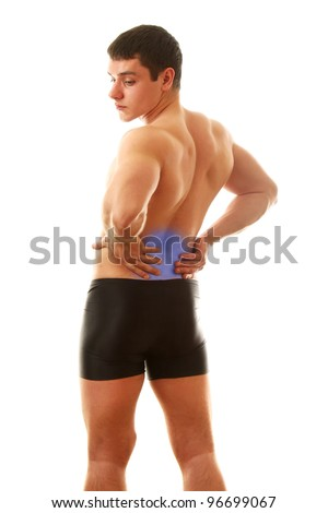 Man with pain in his back on white background - stock photo