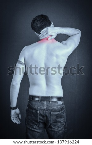 Man with pain in his neck - stock photo