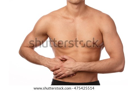 Man with pain in his stomach isolated on white background. Problems with organs of digestion.