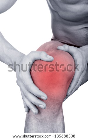 Man with pain in the knee isolated on white background - stock photo