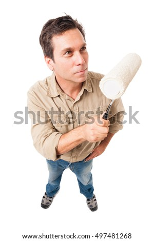Man with paint roller isolated on white background