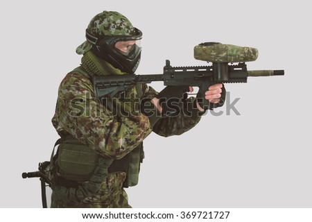 Man with paintball gun
