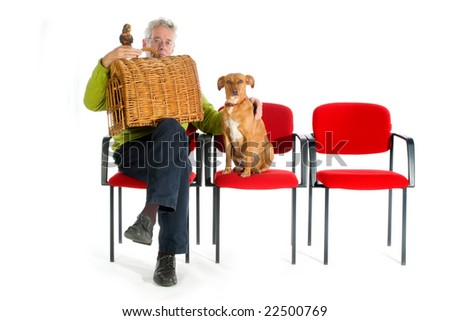 Man with parrot, cat and dog in the waitingroom from the veterinary