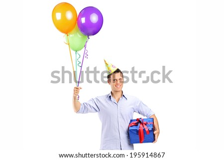 Man with party hat holding balloons and a present isolated on white background