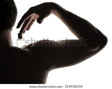 Man with perfume bottle - stock photo