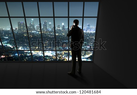man with phone looking in night city - stock photo