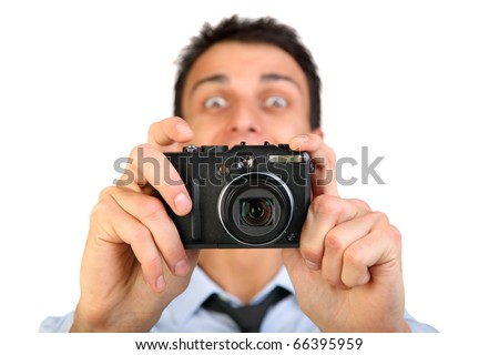 Man with photo camera.Isolated over white