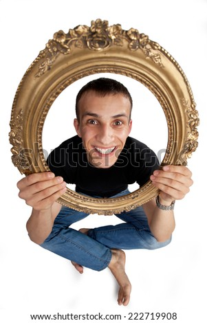 Man with picture frame - stock photo