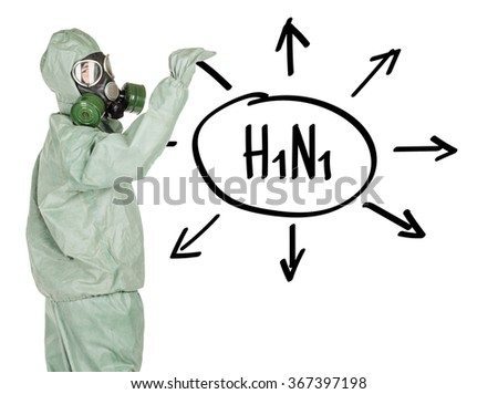 Man with protective mask and protective clothes drawing the word H1N1 on white wall. portrait isolated over white background.  - stock photo