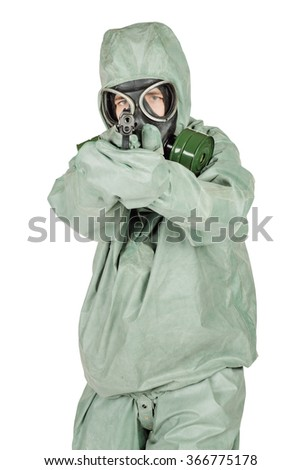 Man with protective mask and protective clothes holding a gun. portrait isolated over white background. - stock photo