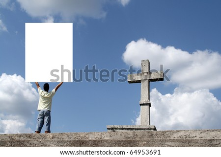 man with publicity board near a cross - stock photo