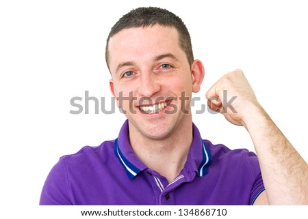 man with purple top cheering