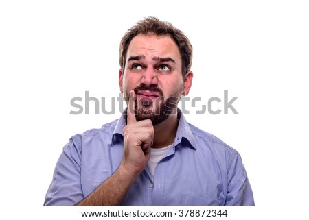 Man with questioning look in his eyes and finger on his cheek - stock photo