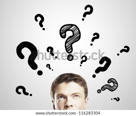 man with questions symbol on a white background - stock photo