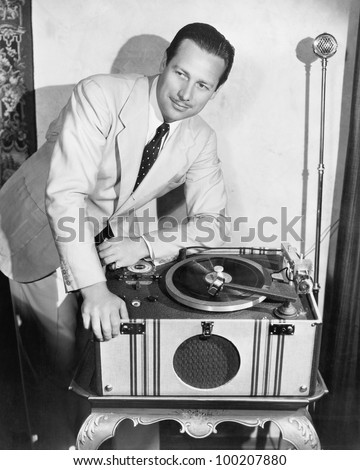 Man with record player - stock photo