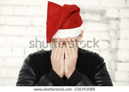 Man with red hat celebrating Christmas eve - stock photo