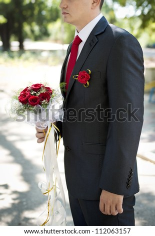 Man with red roses