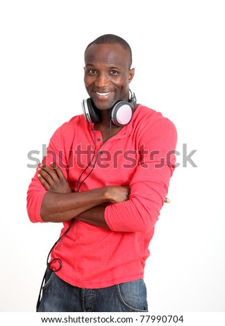 Man with red shirt listening to music with headphones