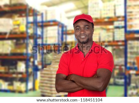 man with red uniform in his workplace
