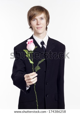 Man with rose in his hands - stock photo