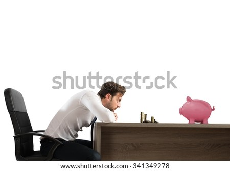 Man with sad expression watching his savings - stock photo