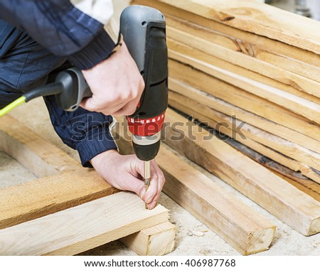Man with screwdriver, Building master with drilling machine,  carpenter working  - stock photo